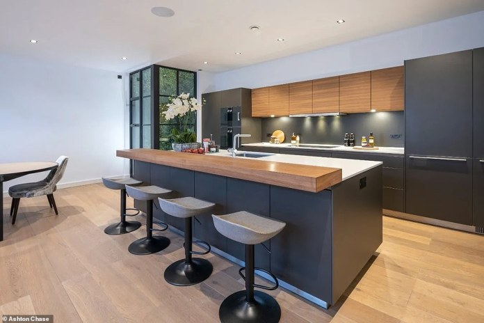 Next to the singer's kitchen (pictured) is an eight-seat dining room table and casual living room area, where the popstar has undoubtedly hosted a bevy of celebrity friends