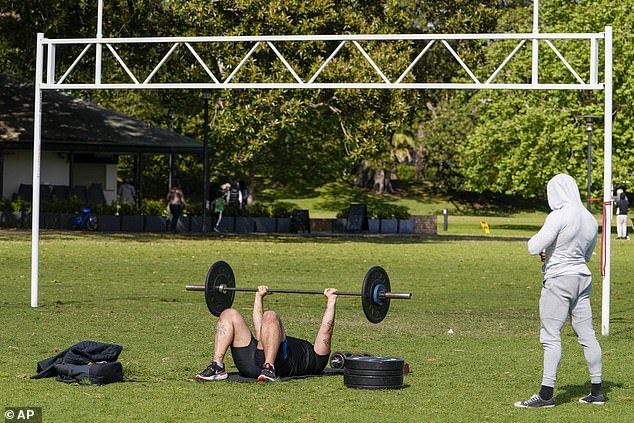 A previous mistake in the health orders which allowed gyms in NSW to offer workouts outside for the unvaccinated has now been fixed (pictured Sydneysiders work out outdoors during lockdown