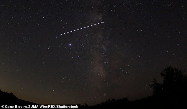The International Space Station (ISS) is seen in the night sky of the Milky Way during the Draconid meteor shower on October 7, 2020 in Frasier Park, Calif.