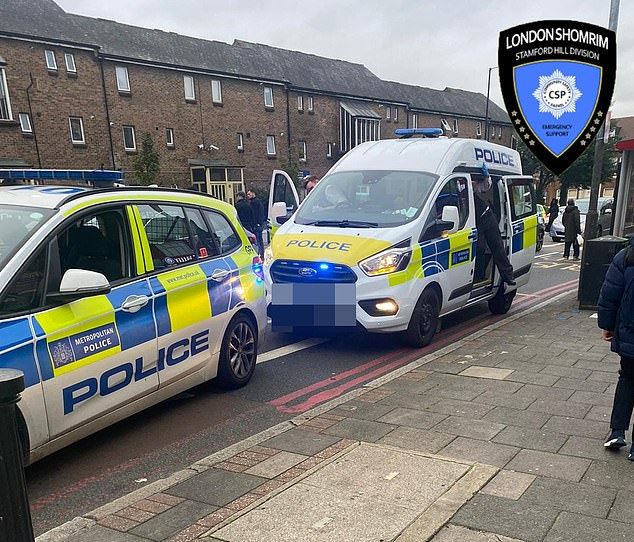 MPS Haringey said they arrested the man on suspicion of attempted kidnap, possession offensive weapon and failing to appear at court. Pictured: Police officers on High Road in Tottenham, North London