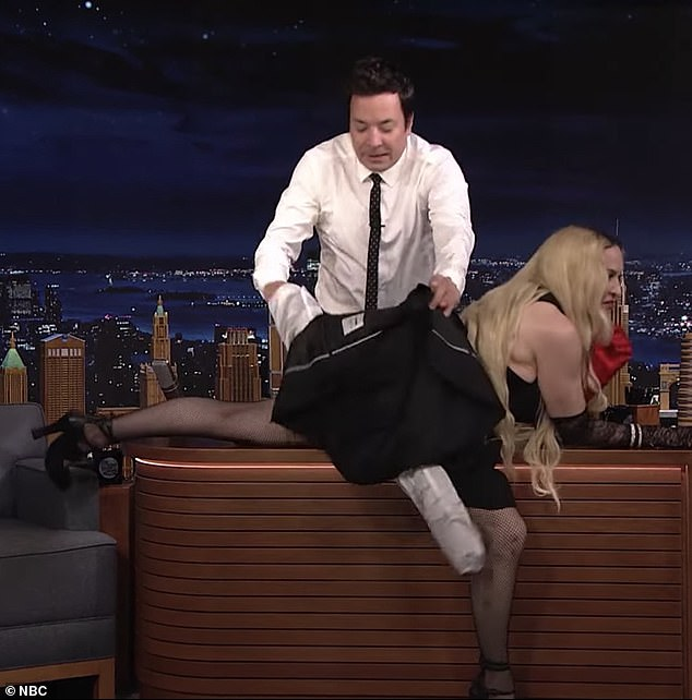 Oops: To protect his own shame, Jimmy said 'No!  Madonna!  stop it!  I do not know what to do.  Stop it now,' before removing her jacket and placing it across Madonna