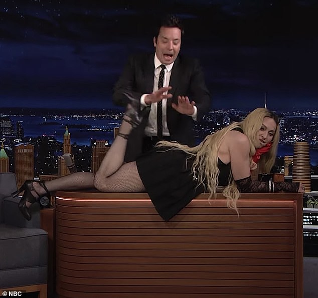 Loving Life: Despite Jimmy's horror, Madonna seemed in great spirits as she raised her feet and laughed
