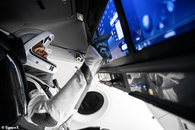 Raja Chari will command the next spaceflight pictured here in the simulator at SpaceX Headquarters in Hawthorne, California.
