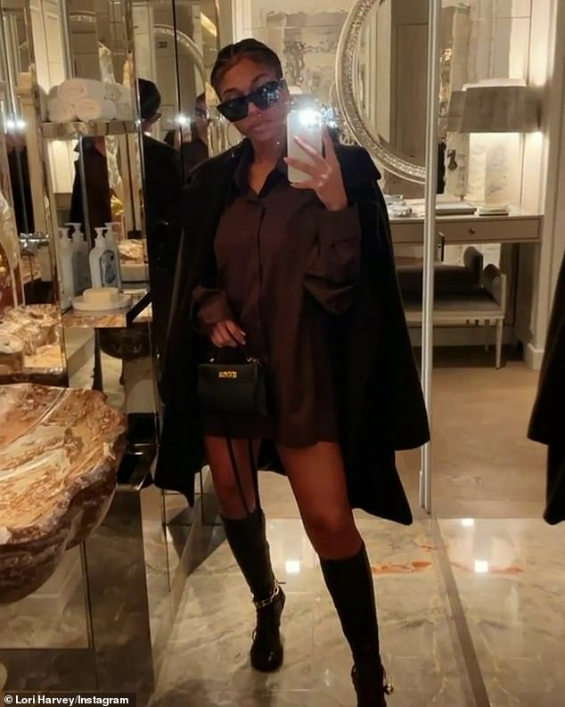 Lap of luxury: She took a mirror selfie in a luxurious powder room with marble accents