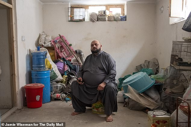 General Ata Sharifi pictured in the Jalalabad basement where he is in hiding from the Taliban