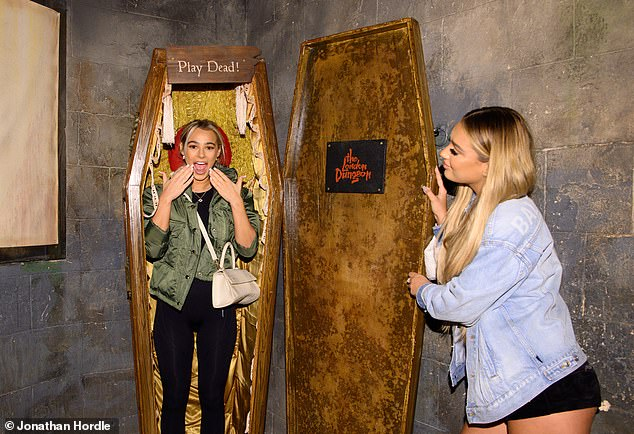 Hilarious: Once the comedian, Lily poses from inside a coffin while pulling a gasping face, as Lucinda holds her friend open for the inside