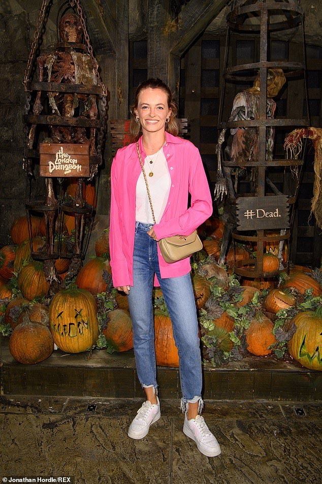 Looking Good: Eliza Batten stood out from the crowd in a flashy pink buttonless shirt, with a white crew neck T-shirt visible beneath