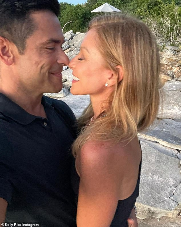 Lasting love:The television host savored a romantic moment with her enduring partner of 25 years as she posted a photo of the pair nose-to-nose on the beach from a getaway for her 51st birthday