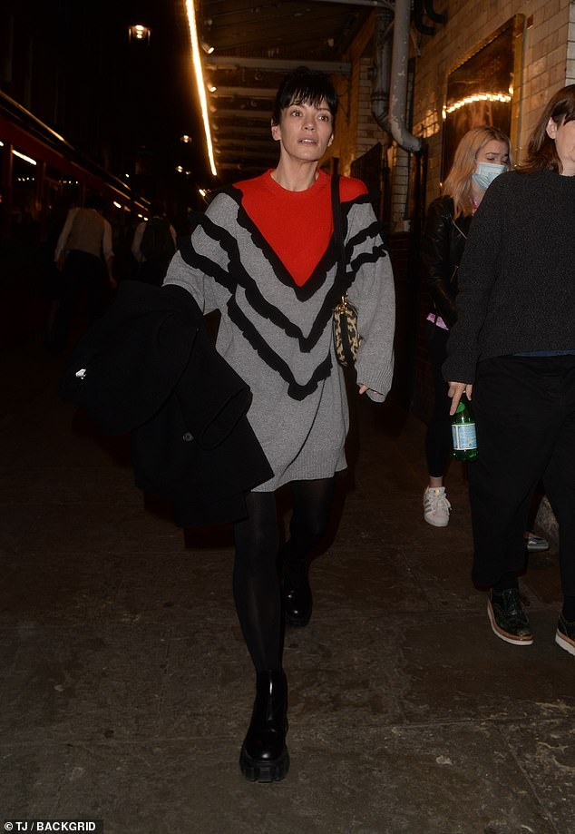 Stunning: The BRIT award winner sported a small leopard-print handbag flaunted by a charcoal leather strap over her shoulder and wore minimal makeup to showcase her natural beauty.