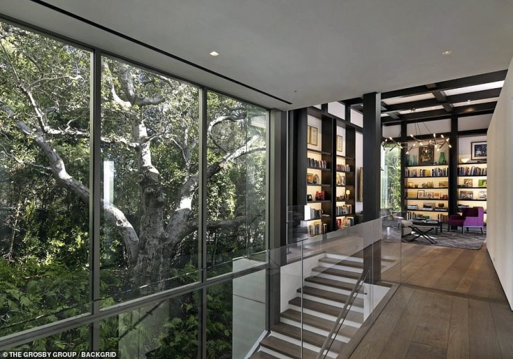 Books everywhere: His home is full of book shelves with art, vases and some of Noah's favorite reads