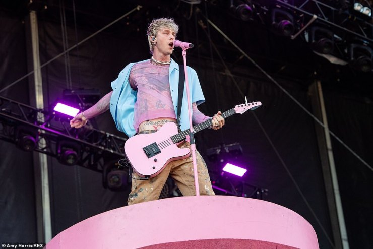 Pink:MGK belted the lyrics to song off his 2020 record Tickets to My Downfall with a bright pink guitar in hand that matched his mic stand and stage platform