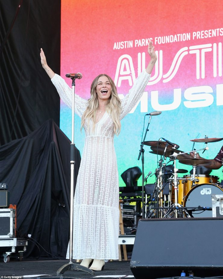 Friendly:LeAnn Rimes stunned in a floor-length boho dress and white cowboy boots while greeting ACL Fest attendees with a friendly wave