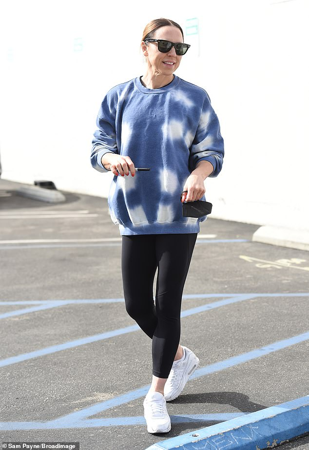 Cozy: Mel C wore a blue and white sweatshirt and skintight black leggings