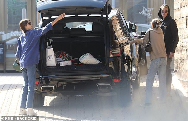Caffeine kick: Kaia was later pictured loading up the boot of the car as they left the cafe