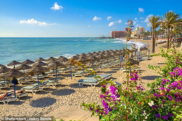 A golden beach in Benalmadena, which isthe oldest part of the Costa del Soland is filled with whitewashed houses
