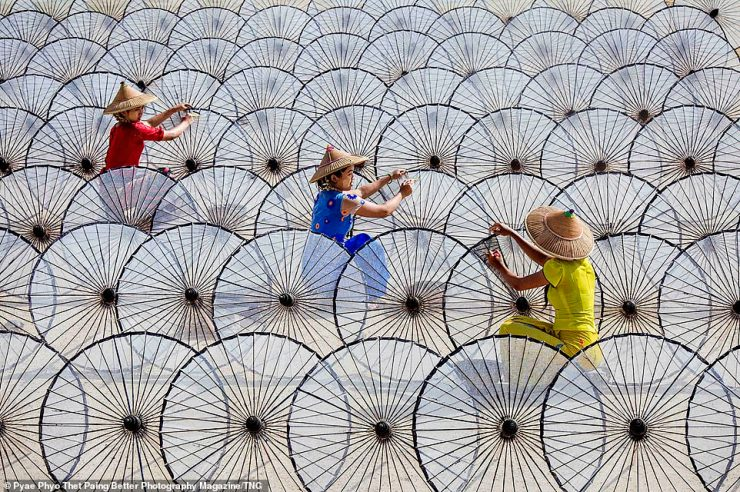 Pyae Phyo Thet Paing also picked up a Silver Award in the Exotic Travel category with this shot of girls working with umbrellas