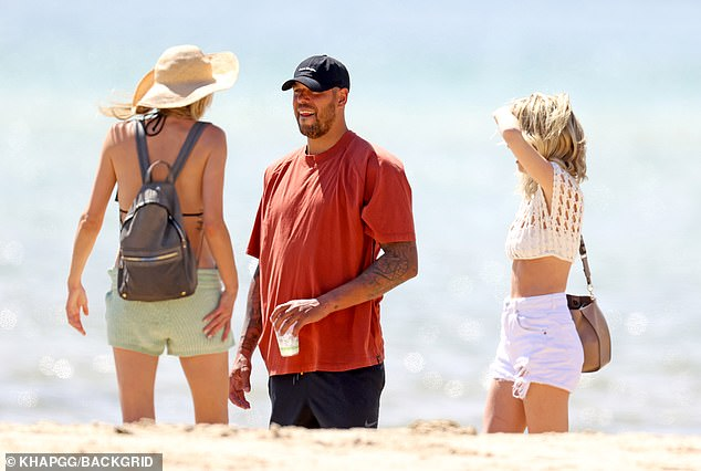 Looking good:Tegan meanwhile looked summer-ready in a white mesh crop top