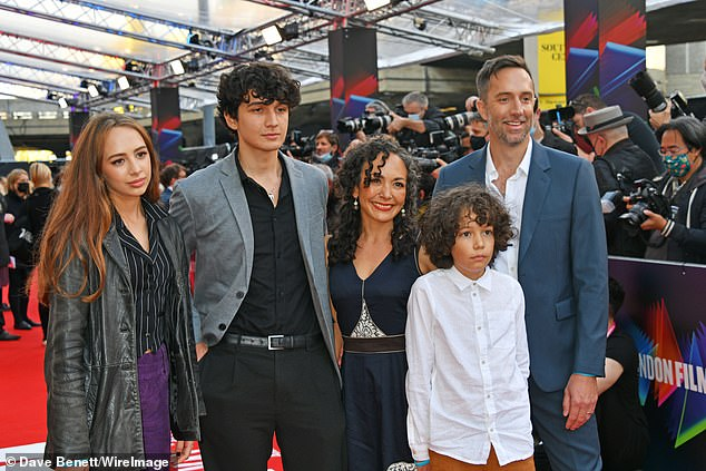 Say cheese: Jean-Philippe Vines (R) and his family also attended the premiere