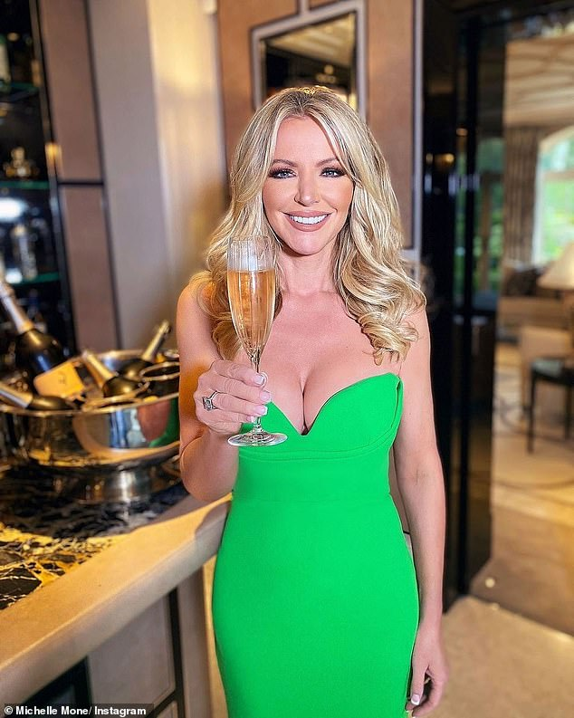 Looking Good: For a different birthday look, Michelle slayed in a green dress as she raised a glass of champagne during an intimate dinner with her closest friends.