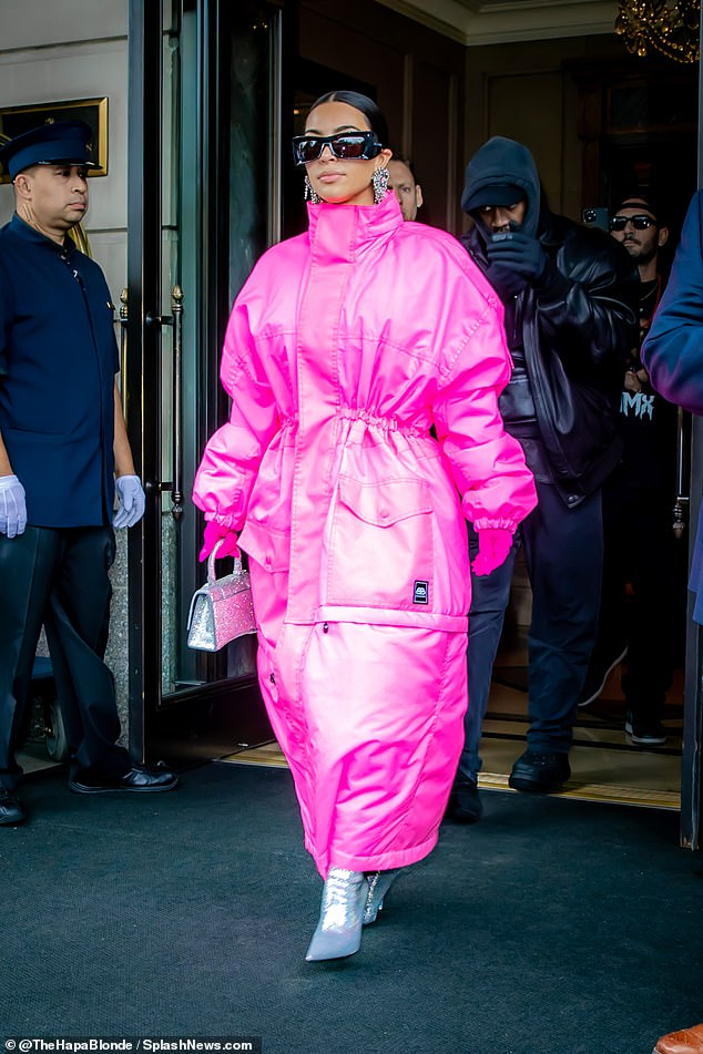 Stepping out: Kim Kardashian proved to need a little support as she enlisted the help of estranged husband Kanye West while leaving her hotel ahead of her Saturday Night Live hosting debut