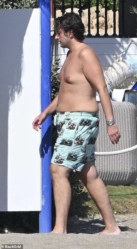 Jetting off! James was seen relaxing on the beach after jetting abroad for a sunny break