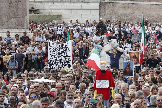 Both employees and employers in Italy (pictured: protest in Rome) risk fines if they do not comply with the rules, causing outrage and protests across the Italian capital