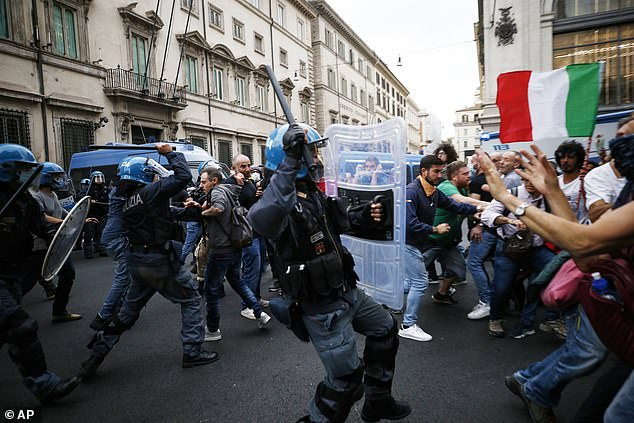 Police clashes with demonstrators during a protest against Covid regulations in Rome on Saturday