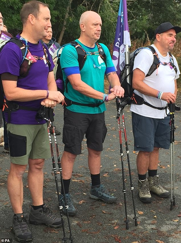 On their way: The group set off on a 300-mile trek on Saturday to raise awareness of the suicide prevention charity Papyrus
