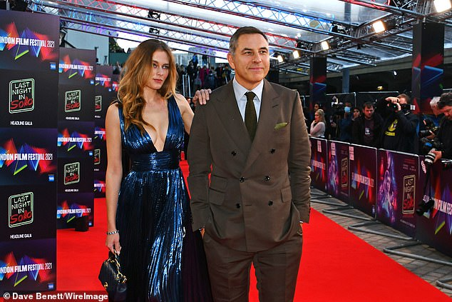 Children's author David looked debonair in a brown suit, which he paired with black suit shoes, as he attended the premiere for Baby Driver director Edgar Wright's latest film