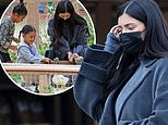 Pregnant Kylie Jenner hides baby bump on a play date at the pumpkin patch with Stormi and True in LA