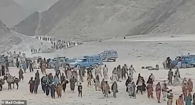 Thousands flee Taliban-held Afghanistan walking miles through the desert across the Pakistani border