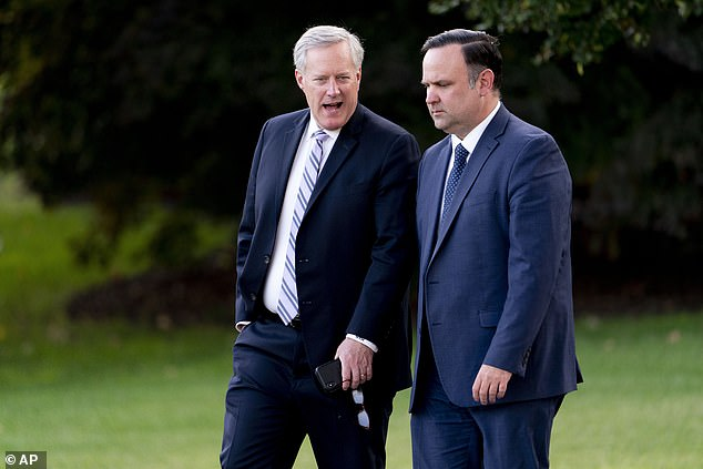 White House social media director Dan Scavino, right, and White House chief of staff Mark Meadows, left, walk to board Marine One with President Donald Trump on Sept. 22, 2020