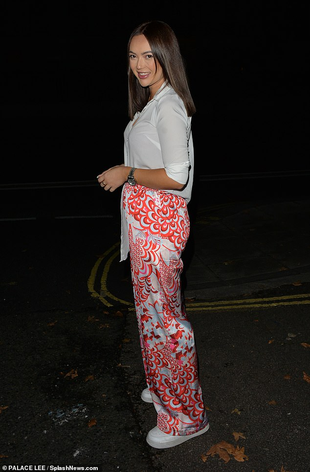 Gorgeous: The brunette beauty wore her luscious locks in a sleek middle parting and completed her ensemble with a pair of casual white trainers