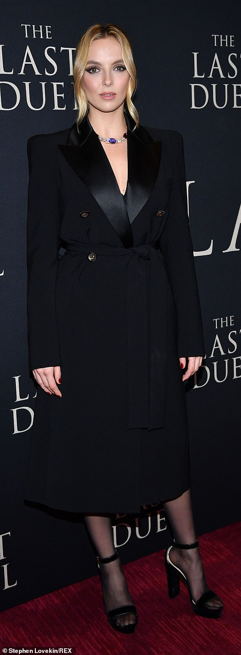 Shining through:The intriguing look featured a double-breasted top with thick satin peaked lapels that helped the Killing Eve star glow