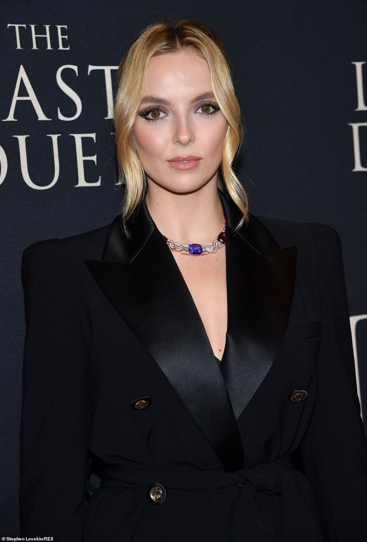 Delicate:The outfit was belted around her midriff to emphasize her hourglass figure, and she contrasted the dark ensemble with her blond hair, which framed her face with delicately twirled strands