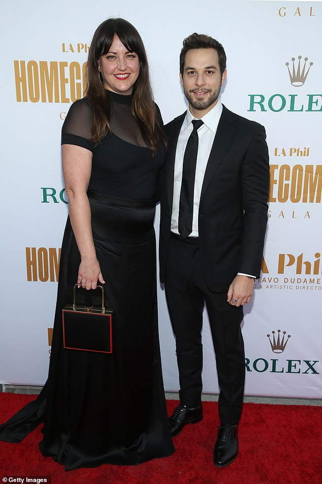 Dynamic duo:Choreographer Kathryn Burns looked classically beautiful in a black dress with a mesh upper half, while posing beside actor Skylar Astin