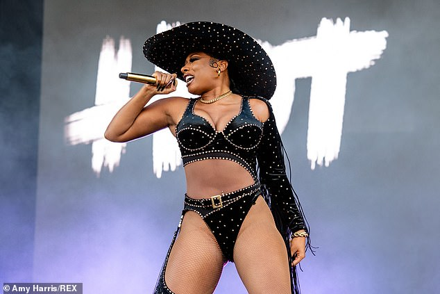 Showstopper: Megan Thee Stallion commanded the stage in a skimpy bedazzled bodysuit during her performance at the A-list celebration of music