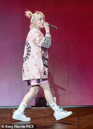 Comfy: The 19-year-old megastar put on a high-energy performance in high-top white Air Force One sneakers and white Nike socks