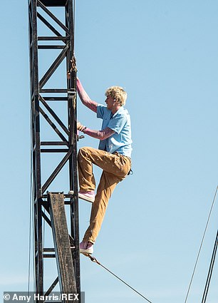 Derelict: MGK climbed to new heights during his Friday performance