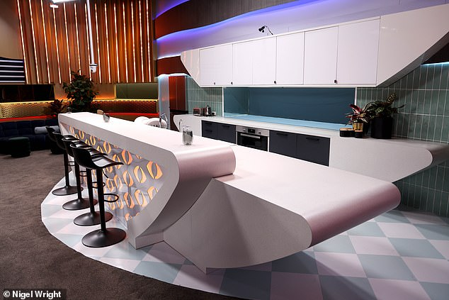 Retro feel: The kitchen and bar area certainly takes on a retro feel with the checkerboard floor and white and blue accents