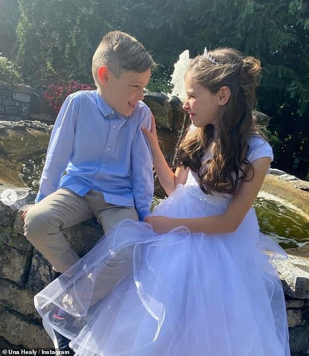 Sweet:Alongside her white dress, Aoife wore silk gloves and a pretty tiara whileTadhg looked smart in a light blue shirt and slacks