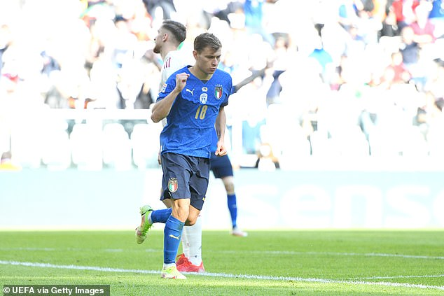 Nicolo Barella celebrates after his goal put Italy in the lead during their clash with Belgium