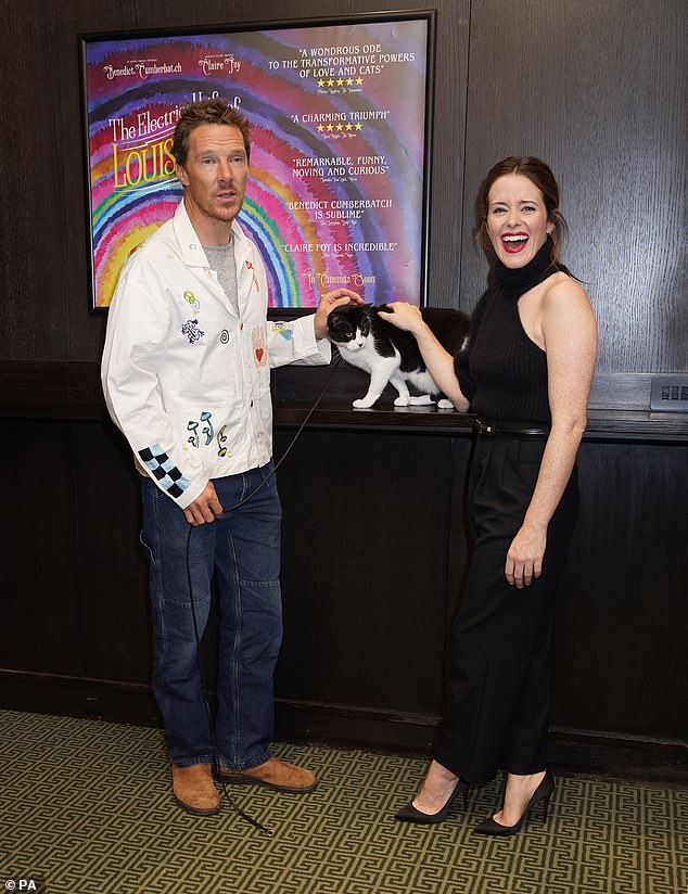 Cute: Benedict looked stylish in a quirky white shirt embellished with colourful patterns which he layered over grey T-shirt