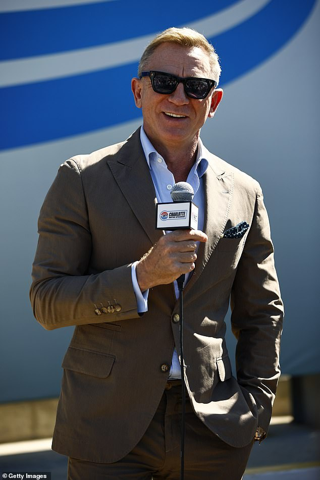 Looking good:Daniel Craig was in attendance at the Roval 400 NASCAR Cup Series' pre-race ceremony at North Carolina's Charlotte Motor Speedway on Sunday