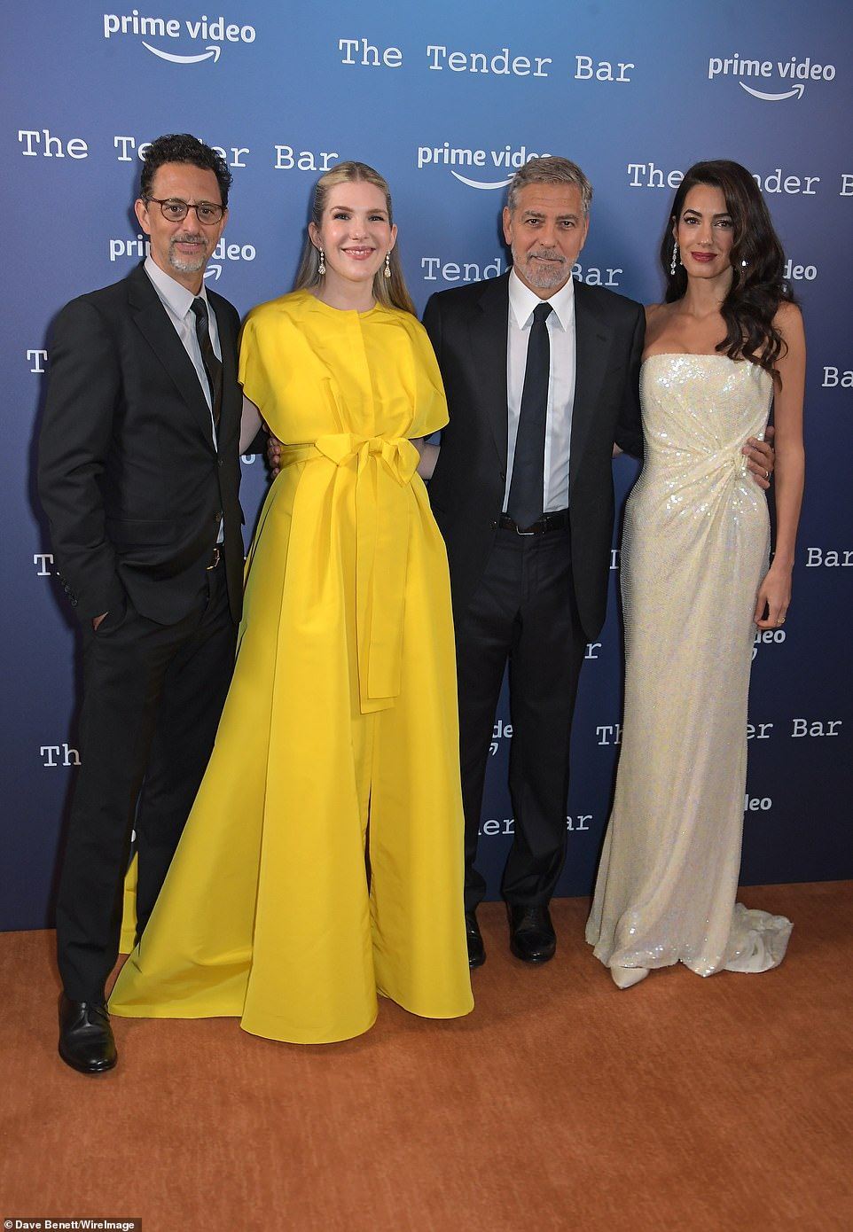 Dapper: The Oceans Eight actor looked suave in a black suit while his stunning wife Amal (far right) was a vision in a beautiful strapless white gown adorned with sequins