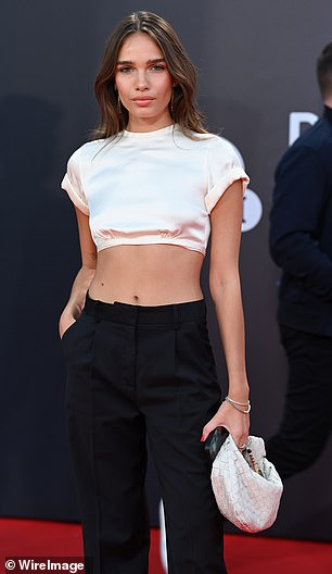 Sophistication: Hana wore a pair of long loose fitted trousers to accentuate her long legs