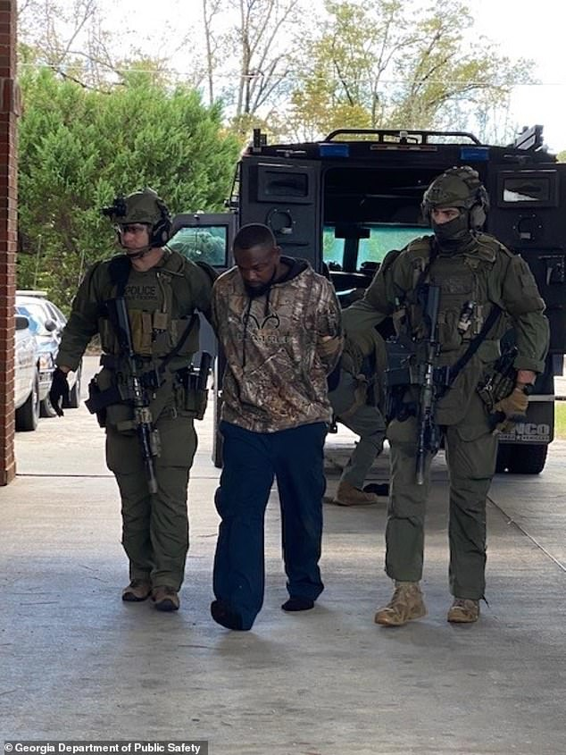 The State of Georgia's SWAT team arrested him without incident following an intense manhunt