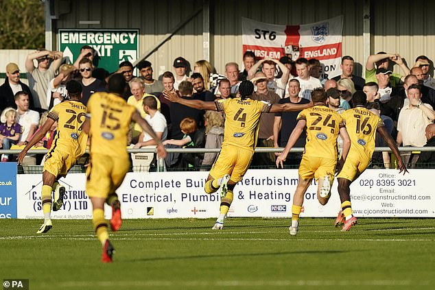 Coby Rowescored the crucial goal in added time ofSutton United's game (above)