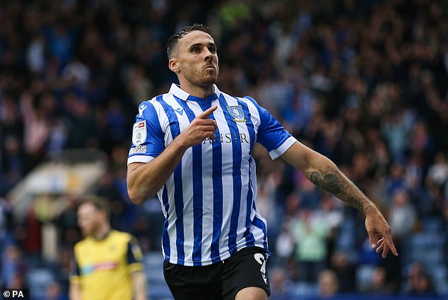 Lee Gregory celebrates scoring for Sheffield Wednesday against Bolton on Saturday