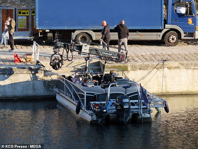 Water scene: A large camera rig was set up on a small boat that was docked nearby, indicating that Reeves was shooting a scene on the water